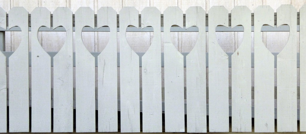 white-fence-with-hearts